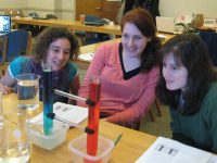 Graduate students work on activities illustrating ocean concepts