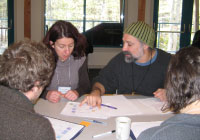 UMaine graduate students and post docs collaborate on a concept map with researcher David Fields